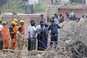 A NDRFteam  during the rescue operation after the twin building collapse at Shahberi village.