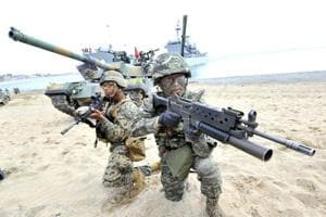 South Korean marines on the seashore in Pohang, 270-kms southeast of Seoul.  Twelve inventive South Korean college students deliberately made themselves overweight to dodge mandatory military service, a branch of the armed forces in Seoul said Tuesday.