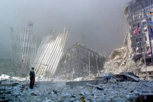 In this photo taken on September 11, 2001, a man stands in the rubble,  after the collapse of the first World Trade Center Tower in New York.