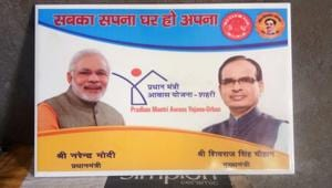 A tile bearing photographs of Prime Minister Narendra Modi and chief minister Madhya Pradesh Shivraj Singh Chouhan to be used in Pradhan Mantri Awas Yojna (PMAY) (Urban)