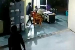 The footage shows the man, armed with a spade, moving quietly down a corridor and hitting the policemen on their head from behind.