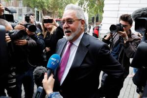 Vijay Mallya speaks to members of the media as he arrives to appear at Westminster Magistrates Court in central London on September 12, 2018, to attend the closing arguments in his extradition hearing.