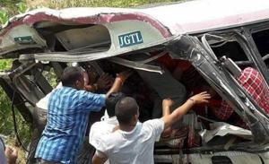 Rescue officials at the accident site where a state-owned Road Transport Corporation bus skidded into a deep gorge, at Jagtial district, on September 11, 2018.