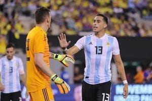 Argentina goalkeeper Franco Armani is congratulated by teamamte Ramiro Funes Mori after Armani made a stop in the first half against Colombia.