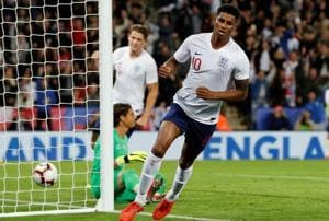 Marcus Rashford celebrates after scoring against Switzerland.