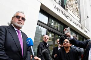 Vijay Mallya stands outside Westminster Magistrates Court in London, Britain, September 12, 2018. REUTERS/Toby Melville