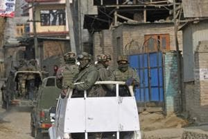 Security personnel patrol at village Barsu in south Kashmir