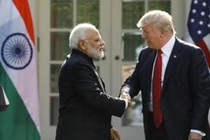 U.S. President Donald Trump (R) greets Indian Prime Minister Narendra Modi during their joint news conference in the Rose Garden of the White House in Washington, U.S., June 26, 2017.