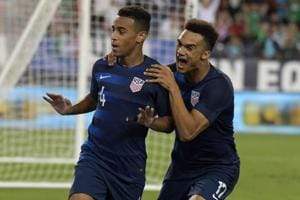 United States midfielder Tyler Adams (4) celebrates with defender Antonee Robinson after scoring a goal against Mexico.
