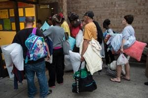 People line up to enter a hurricane shelter at Trask Middle School in wilmington, North Carolina, on September 11, 2018.