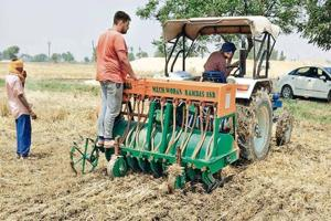 A farmer using the Happy Seeder to manage stubble in his paddy field in Patiala district.