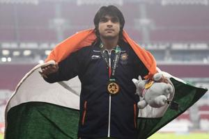 Gold medallist Neeraj Chopra celebrates during the victory ceremony for the men