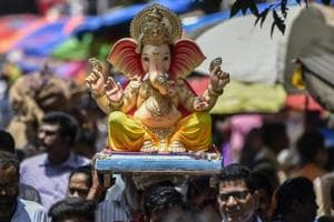 Devotees carry a Ganesha idol of from a studio to their  place of worship for the  Ganesha Chaturthi festival at Dadar in Mumbai,  Wednesday, September 12, 2018.