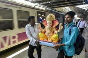 Photos: Devotees bring Ganesha home as 10-day festival begins