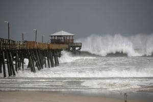 Waves crash around the Oceana Pier as the outer edges of Hurricane Florence begin to affect the coast, on September 13, 2018, in Atlantic Beach, United States. Coastal cities in North Carolina, South Carolina and Virgnian are under evacuation orders as the Category 2 hurricane approaches the United States.