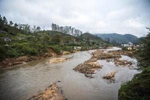 Debris from a landslide sits in a river that runs near tea estates near Munnar in the district of Idukki, Kerala, India, on Saturday, Aug. 25, 2018. Kerala has received 42 percent more monsoon rain than normal since June 1, according to the India Meteorological Department, compared with a deficit of 8 percent for the entire country. Photographer: Prashanth Vishwanathan/Bloomberg