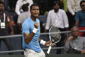 India Ramkumar Ramanathan exaults after taking point against span F Lopez during Davis Tie between India and Spain at DLTA in New Delhi, India, on Friday, September 16, 2016.
