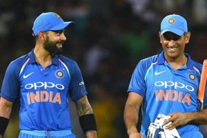 In this file photo taken on September 03, 2017, Indian cricket captain Virat Kohli (L) celebrates with teammate Mahendra Singh Dhoni (R) after victory in the final one day international (ODI) cricket match between Sri Lanka and India at The R. Premadasa Stadium in Colombo.