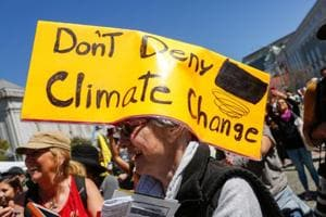 A woman wears a sign on her head at Civic Center Plaza after marching in the