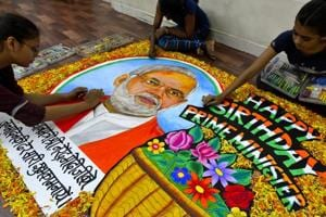 Mumbai students from Gurukul School of Art draw a painting of PM Narendra Modi to mark his birthday on September 16, 2017.