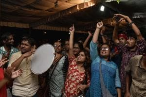 AISA supporter shouts slogans during an open debate of President candidates for the upcoming JNU student elections at the campus in New Delhi.
