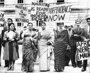 Old ties; new roots:Supporters of Seewoosagur Ramgolam, the Prime Minister of Mauritius, before he spoke for Mauritian independence during a constitutional conference at Lancaster House, London, on July 19, 1965.