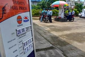 A board displays the petrol and diesel prices at a petrol pump as the fuel prices soar, in Guwahati on August 28, 2018.