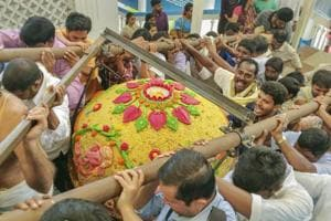 Devotees carry a laddu, weighing about 580 kgs, to offer to Lord Ganesh at Film Nagar Daiva Sannidhanam on the occasion of Ganesh Chaturthi in Hyderabad on September 13.