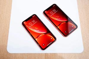 Apple iPhone XR models rest on a table during a launch event on September 12, 2018, in Cupertino, California.