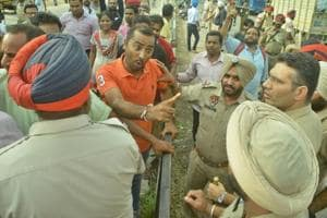 Relatives of the accident victims blocking the road and arguing with police near Basti Jodhewal Chowk in Ludhiana on Thursday.