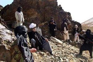 (In this photograph taken January 23, 2010, Taliban fighters pose during a patrol in Ghazni province of Afghanistan.