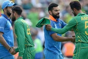 Mohammad Amir of Pakistan shakes hands with Virat Kohli of India after the ICC Champions Trophy final match between India and Pakistan at the Kia Oval cricket ground on June 18, 2017 in London, England.