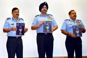 Air Chief Marshal BS Dhanoa (2nd from R), releases a souvenir during the inauguration of 57th Annual Conference of Indian Society of Aerospace Medicine  in Bengaluru on Sep 14, 2018.