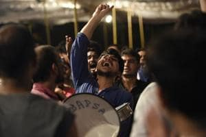 Supporters of different parties shout slogans in support of their candidates during the presidential debate, at Jawaharlal Nehru University.