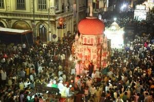 Muslims carrying Taziyas, a replica of the mausoleum of Imam Hussain during a Muharram procession in Surat .
