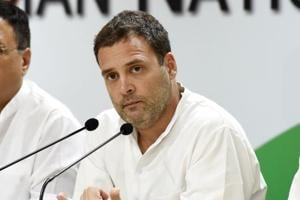 Congress President Rahul Gandhi (C) speaks as chief spokesperson Randeep Surjewala (L) and senior leader Ashok Gehlot (R) look on, during a press conference on Vijay Mallya