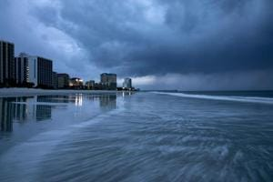 """Hurricane-force winds began whipping North Carolina, as federal emergency management officials warned that the Category 2 hurricane, while weakening slightly, remains a """"very dangerous storm"""" capable of wreaking havoc along a wide swathe of the coast."""