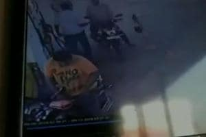 A young man's motorcycle caught fire when he started it after filling up his petrol tank in Tamil Nadu's Tirunelveli.