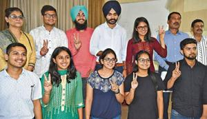 (Second from left, back row) Newly elected PUCSC joint secretary Vipul Atray, secretary Amarinder Singh, vice-president Daler Singh and president Kanupriya; and (from left, front row) elected executive members Vaibhav Mahajan, Varinda, Vinny Kaur, Ramanpreet Kaur and Anand Kumar during the oath-taking ceremony at Panjab University on Friday.