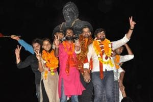 Winning ABVP candidates pose after results of DUSU elections were declared.