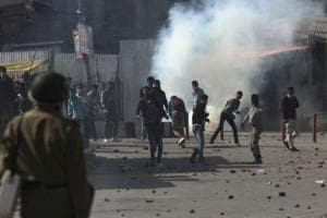Protesters throwing stones at policemen during a protest in Srinagar.