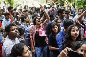 Jawaharlal Nehru University students wait to place their votes during the students