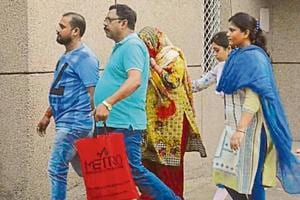 Yadav Singh's wife Kusum Lata (face hidden) appeared before a CBI court after orders from the Supreme Court.