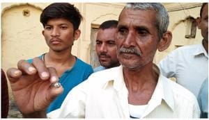 Bundelkhand labourer Prakash with diamond that he found in leased land in diamond mining area of Panna district