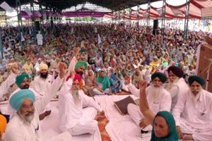 Farmers raising slogans against the central government's new agricultural policy during their state level protest rally in Tarn Taran on Sunday.
