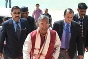Uttarakhand Chief Minister TS Rawat going inside the assembly.