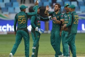 Pakistan cricketer Usman Khan (C) celebrates with teammates after he dismissed Hong Kong batsmans Scott McKechnie during the one day international (ODI) Asia Cup cricket match between Hong Kong and Pakistan at the Dubai International Cricket Stadium in Dubai on September 16, 2018.