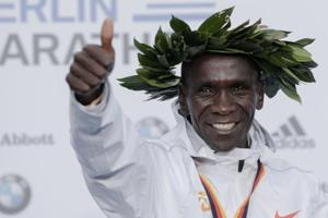 Gold medalist Eliud Kipchoge celebrates during the winning ceremony for the 45th Berlin Marathon in Berlin.