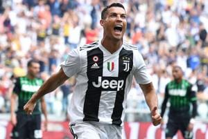 Cristiano Ronaldo celebrates after scoring during Serie A match between Juventus and Sassuolo.
