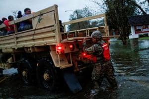 People being rescued by a member of the US Army during the passing of Hurricane Florence in the town of New Bern, North Carolina on September 14, 2018.